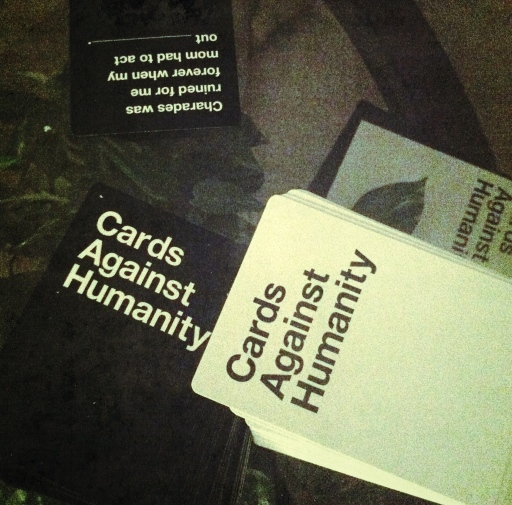 Playing a card game with friends that'll probably result in all of us going to hell.