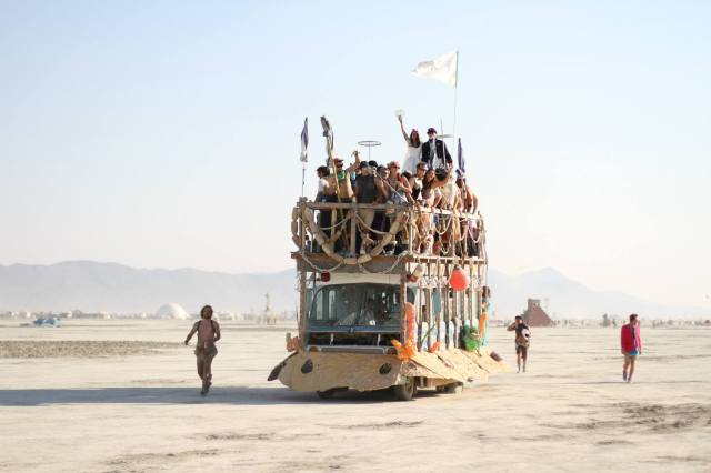 Credit: Kim Clune We took an Art Car out to the middle of the deep playa where Eric and his groomsmen had built an alter of Pacific Northwest drift wood.