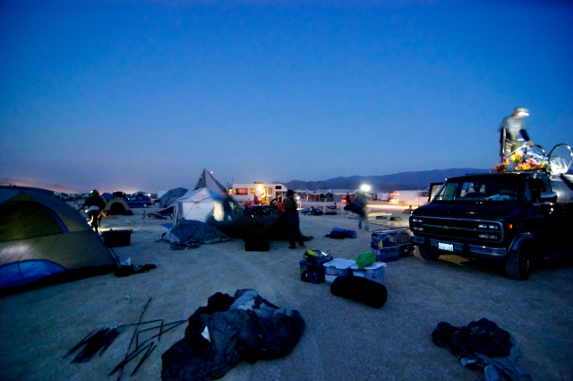 "We finally made it through the gate and into camp as the sun was rising. The first shape I could make out was a ship. Yes, a ship with masts parked next to our tent. It was the first of many ""art cars"" we would see out on the playa."