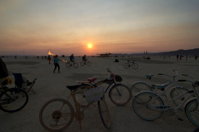 Sunrise over the playa and all the bikes strewn in front of the Temple