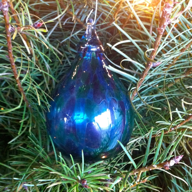 This year, to commemorate our first full year in the Pacific Northwest Jeff gave me a hand blown blue and green glass raindrop ornament from a local Seattle artist. This is one of the biggest glass blowing regions of the world and some ash from Mount St. Helens is included in this piece.