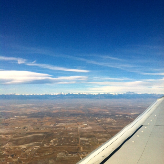 Flying into Denver. Nice to see the snow capped Rockies in the distance. Note the blue sky - the weather there was great, but the Hercules snowpocalypse had wreaked havoc on the other planes' schedules so we were delayed six hours here.