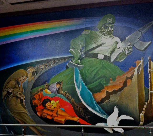 The murals start with biological warfare destroying the planet.