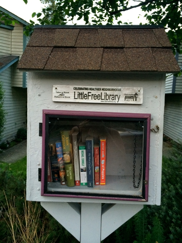 "I took a quiz the other day that was ""How Seattle are you?"" Answer: Very much. One of the questions was ""Do you love your neighborhood and think it's better than all the other neighborhoods and defend it as such?"" Yep, I love the Greenlake/Wallingford area a lot. How can you not with little cool libraries like this in neighbor's yards?"