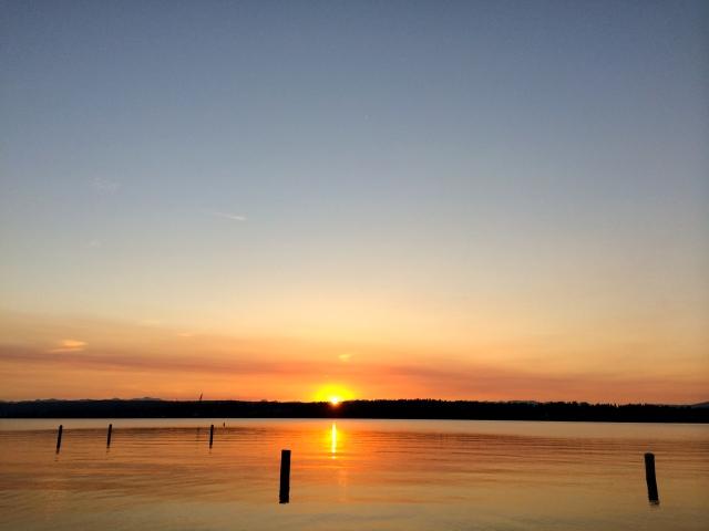 Sun peaking over Lake Washington