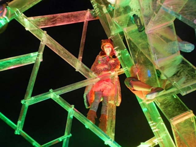 Climbing brightly lit plexiglass sculptures.