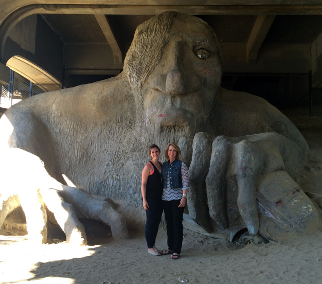 My mom and I in front of the Fremont Troll under the Aurora Bridge in Fremont