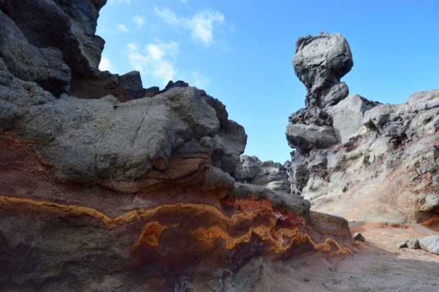 Mushroom shaped rock. The red deposits in the lava are from when the island was relatively young.